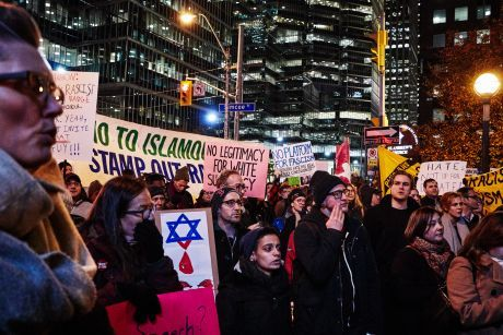 Protesters oppose Steve Bannon in Toronto