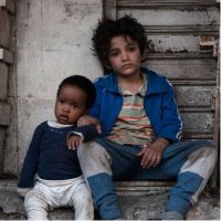 Still image from the film Capharnaüm showing two young children