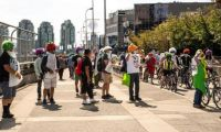 """Ride for Rights"" demonstration in August 2020 highlighting the demands for justice for migrant workers, such as safe housing, open work permits, and pathways to permanent residency."