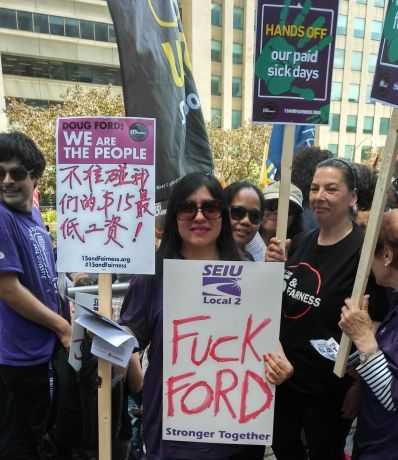 Janitors at Fight for $15 and Fairness rally