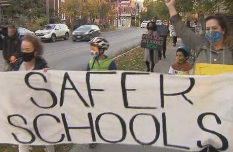 """Protest with banner saying """"Safer schools"""""""